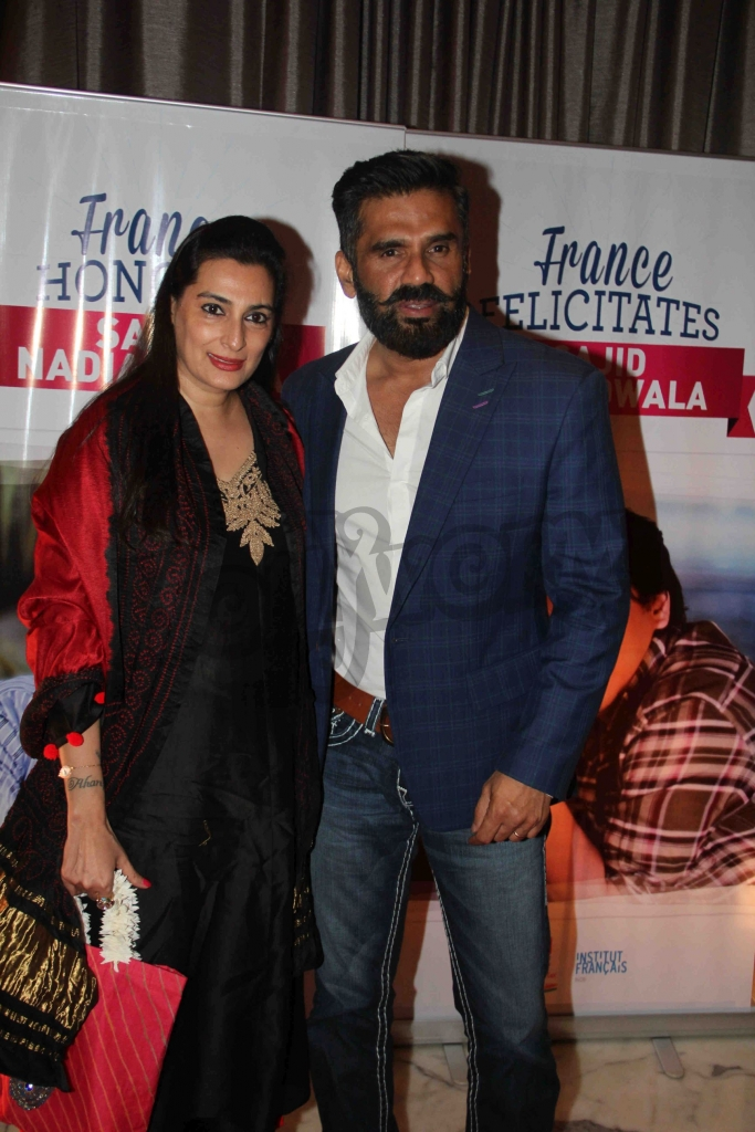 Bollywood actor Suniel Shetty along with his wife Mana Shetty during an event where bollywood filmmaker Sajid Nadiadwala was conferred with an insignia of 'Chevalier des Arts et des Lettres' by Alexandre Ziegler, The Ambassador of France in Mumbai, India on September 21, 2016. (Utsav Devdutta/SOLARIS IMAGES)