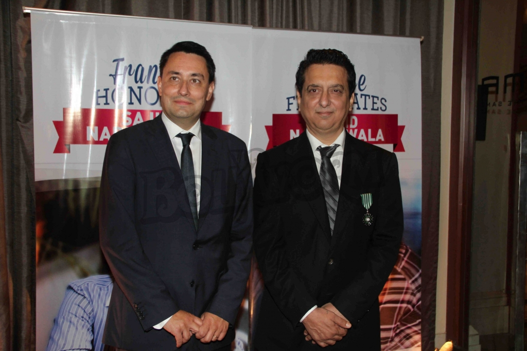 The Ambassador of France, Alexandre Ziegler and Bollywood filmmaker Sajid Nadiadwala during an event where bollywood filmmaker Sajid Nadiadwala was conferred with an insignia of 'Chevalier des Arts et des Lettres' by Alexandre Ziegler, The Ambassador of France in Mumbai, India on September 21, 2016. (Utsav Devdutta/SOLARIS IMAGES)