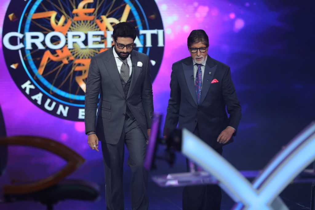 Abhishek Bachchan with Amitabh Bachchan on KBC 9